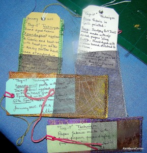 Reverse of tags showing pocket containing notes on construction